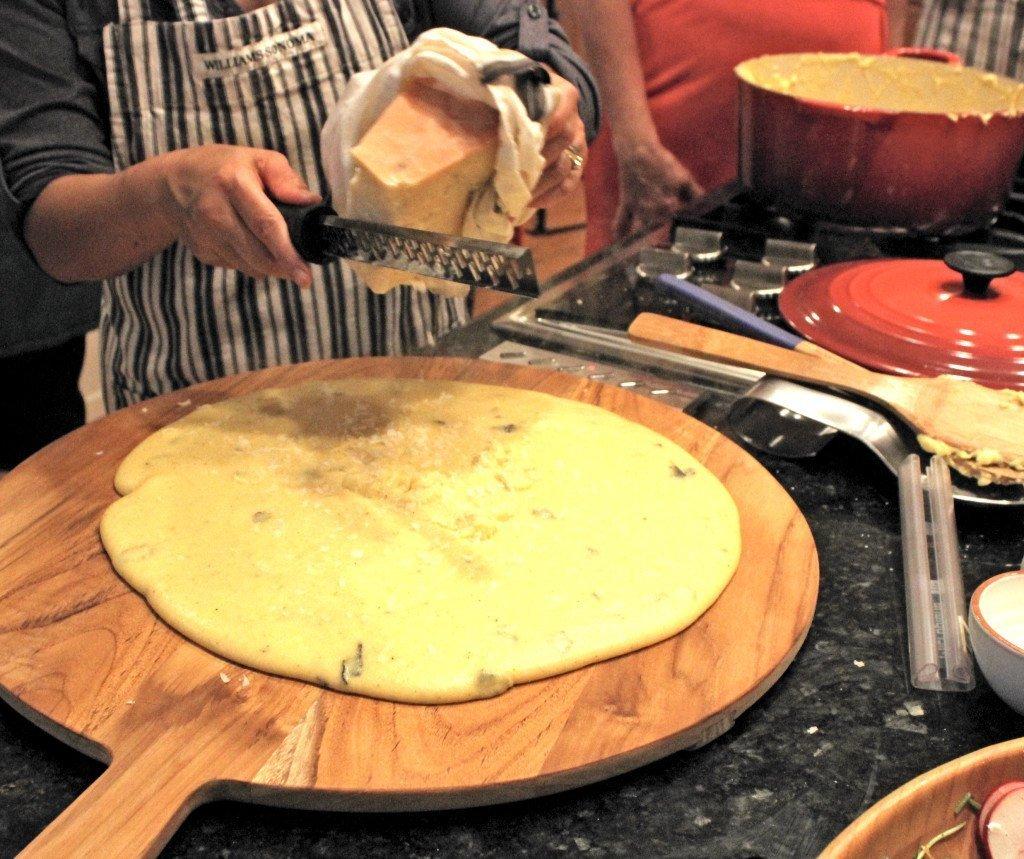 grating cheese on polenta