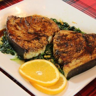 Feast of the Seven Fishes: Seared Swordfish with Citrus Balsamic Glaze on a Bed of Spinach