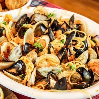 Feast of the Seven Fishes: Linguini with Clams and Mussels in a Spicy Red Sauce
