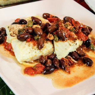 Feast of the Seven Fishes: Baked Halibut with Cherry Tomatoes, Kalamata Olives and Caper Berries
