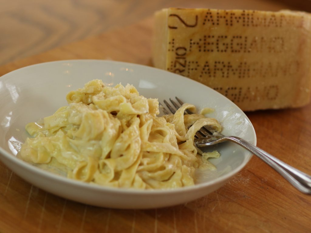 Fresh pasta alfredo fork